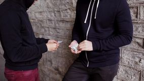Addict buying dose from drug dealer on street 46 stock video