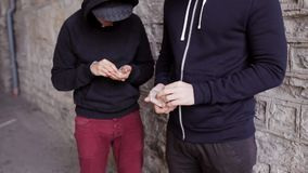 Addict buying dose from drug dealer on street 32 stock video footage