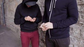 Addict buying dose from drug dealer on street 45. Drug trafficking, crime, addiction and sale concept - addict buying dose from drug dealer on street stock footage