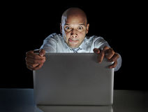 Addict man at computer laptop watching porn internet addiction concept Royalty Free Stock Photography