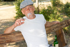 Addict smoking a joint of marijuana Royalty Free Stock Images