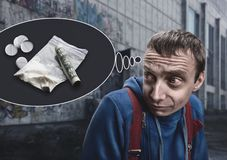 Addict in the street. Addict is thinking about drugs in the street stock photography
