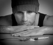Addict, a syringe, the drugs and heroin close up Stock Images