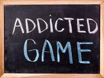Addicted game  word on blackboard Stock Photo