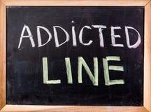 Addicted line  word on blackboard Stock Photo