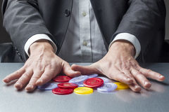 Addicted male entrepreneur playing with money for concept fo risk management Stock Photography