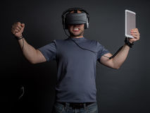 Addicted man technology and video games. Addicted man to technology, virtual reality and video games going crazy. Modern addictions concept Royalty Free Stock Photo