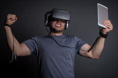 Addicted man technology and video games. Addicted man to technology, virtual reality and video games going crazy. Modern addictions concept Stock Images