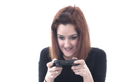 Addicted playing girl with game controller Stock Images