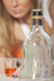 Addicted to alcohol. Young woman addicted to alcohol - focus on glass stock photos