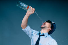 Addicted to alcohol policeman Stock Image