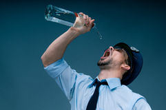 Addicted to alcohol policeman royalty free stock images