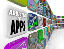 Addicted to Apps Words Mobile Software Tile Display. Addicted to Apps words on app tiles to illustrate our growing reliance on application and software on mobile Stock Images