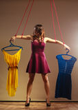 Addicted to shopping woman girl marionette with clothes Stock Image