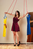 Addicted to shopping woman girl marionette with clothes Royalty Free Stock Images