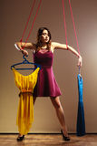 Addicted to shopping woman girl marionette with clothes Stock Photo
