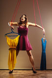 Addicted to shopping woman girl marionette with clothes Royalty Free Stock Photography