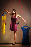 Addicted to shopping woman, marionette on string. Stock Image