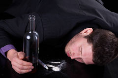 Addicted worker of corporation. Worker of corporation addicted to alcohol and drugs Stock Photo
