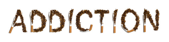 ADDICTION. Written with destroyed cigarettes Royalty Free Stock Photos