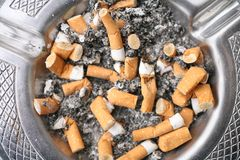 Addiction. Close up shot of cigarettes butt in ashtray Stock Photography