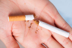Addiction. Broken cigarette on hand. Quit smoking Stock Photo