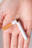 Addiction. Broken cigarette on hand. Quit smoking Royalty Free Stock Photo
