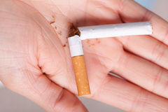 Addiction. Broken cigarette on hand. Quit smoking Stock Images