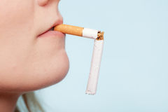 Addiction. Broken cigarette in mouth. Quit smoking Royalty Free Stock Image