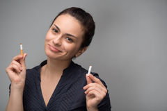 Addiction. Closeup of young attractive woman Stock Photography