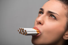 Addiction. Closeup of young attractive woman with Royalty Free Stock Images