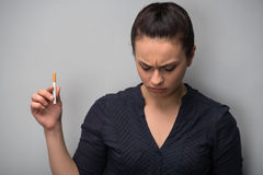 Addiction. Closeup of young woman determined girl Stock Images