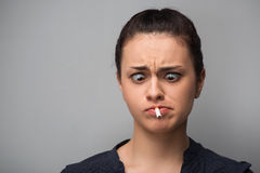 Addiction. Closeup of young woman determined girl Royalty Free Stock Images