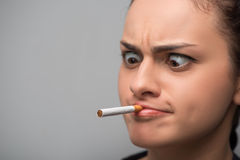 Addiction. Closeup of young woman determined girl Royalty Free Stock Photos