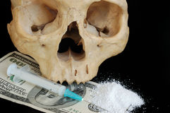 Addiction concept. Skull,narcotic, money and syringe against black Royalty Free Stock Image