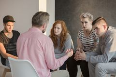 Addiction counselor and his patients Royalty Free Stock Photography