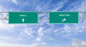 Addiction and family. Road sign to addiction and family Royalty Free Stock Images