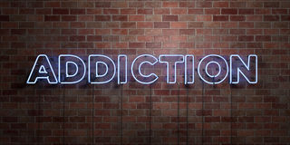 ADDICTION - fluorescent Neon tube Sign on brickwork - Front view - 3D rendered royalty free stock picture. Can be used for online banner ads and direct mailers Stock Image