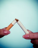 Addiction. Hands breaking cigarette. Quit smoking. Stock Photo