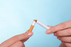 Addiction. Hands breaking cigarette. Quit smoking. Stock Image