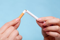 Addiction. Hands breaking cigarette. Quit smoking. Royalty Free Stock Photography