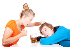Addiction - problems with alcohol. Drunk men and his girlfriend Stock Photography