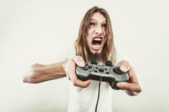 Stressed man playing on pad Stock Photos