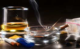 Addictive substances, including alcohol, cigarettes and drugs.  Royalty Free Stock Photo