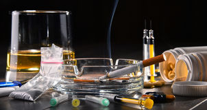Addictive substances, including alcohol, cigarettes and drugs.  Royalty Free Stock Images