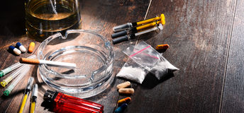 Addictive substances, including alcohol, cigarettes and drugs.  Royalty Free Stock Photography