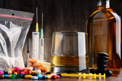 Addictive substances, including alcohol, cigarettes and drugs. Variety of addictive substances, including alcohol, cigarettes and drugs Royalty Free Stock Photography