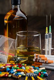Addictive substances, including alcohol, cigarettes and drugs. Variety of addictive substances, including alcohol, cigarettes and drugs Stock Photography