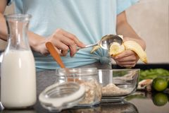 Adding banana in muesli stock image