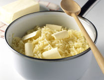 Adding the butter Stock Photography